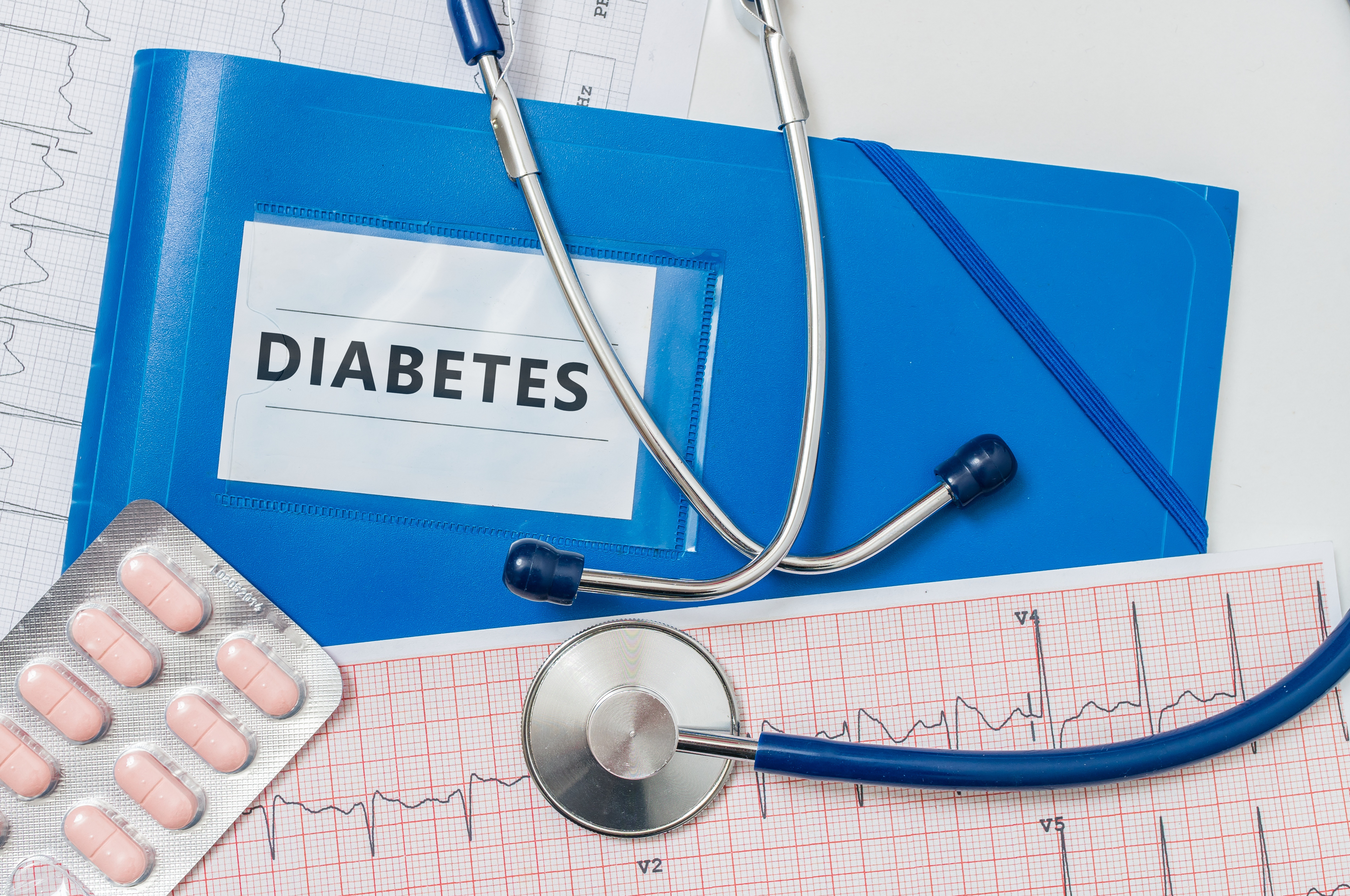 Blue folder with Diabetes diagnosis and stethoscope.
