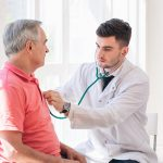 Senior man being examined by a doctor